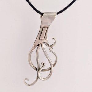 Silver art nouveau pendant with brass detail