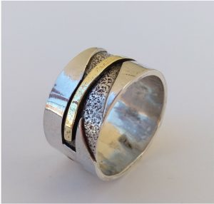 Silver ring with brass band