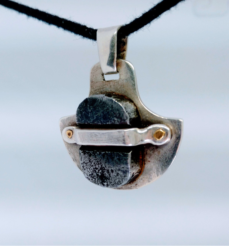 Silver pendant with forged iron detail
