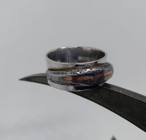 Silver ring with iron and copper detail