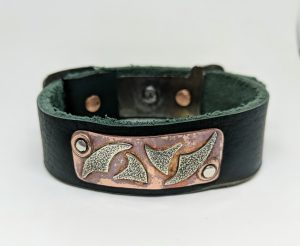 leather bracelet with copper and silver decoration