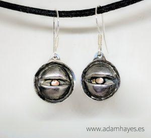Silver and copper eye earrings