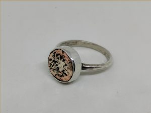 silver ring set with copper