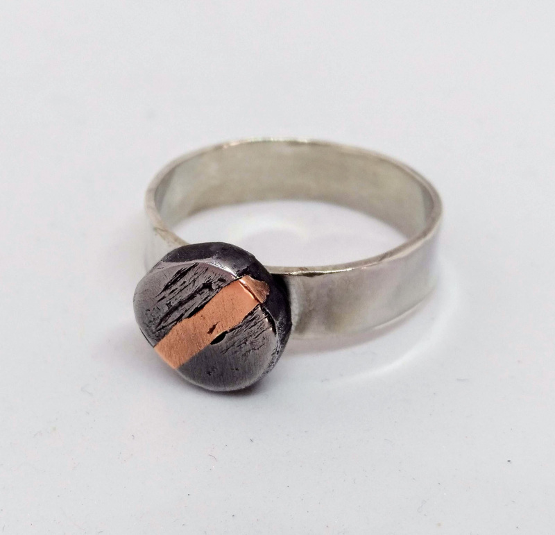Silver ring with forged iron and copper detail