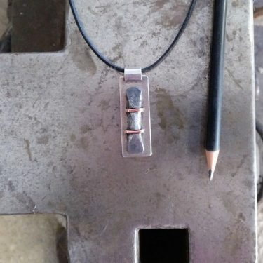 Silver, iron and copper pendant
