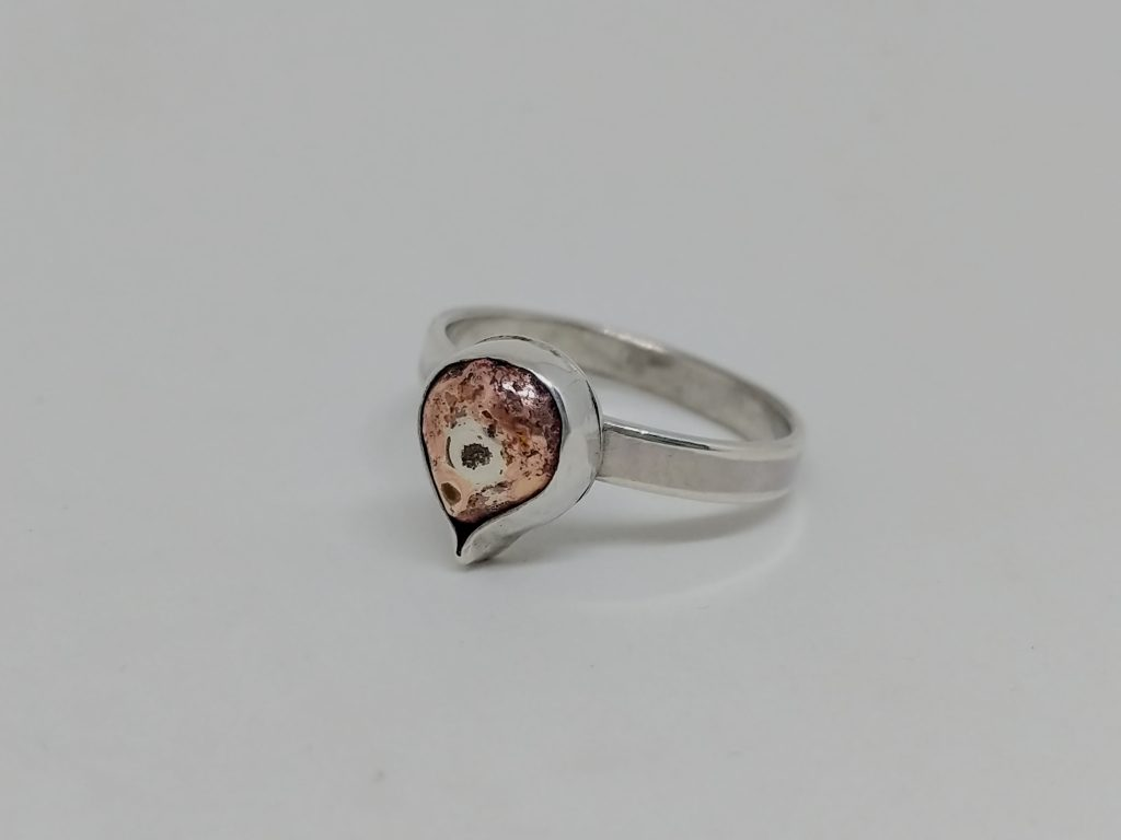 silver ring set with copper teardrop